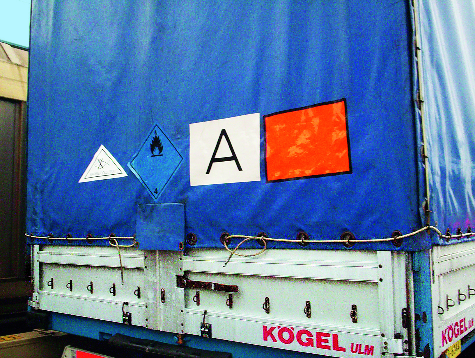 Semi-trailer correctly marked for waste and hazardous goods during sea transport